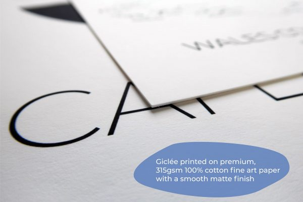Close up photograph of premium fine art paper with giclee printed text